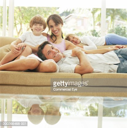 Family relaxing in couch, portrait : Stock Photo