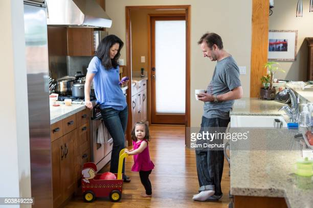Family relaxing in kitchen