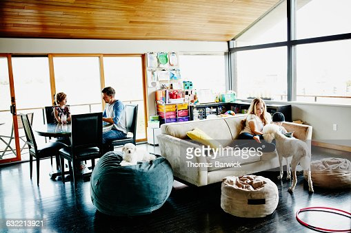 Family relaxing in living room of home