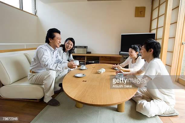 Family relaxing in living room