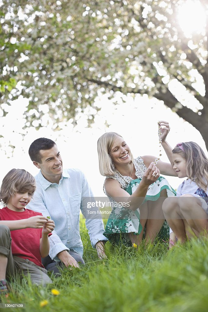 Family relaxing in park : Stock Photo
