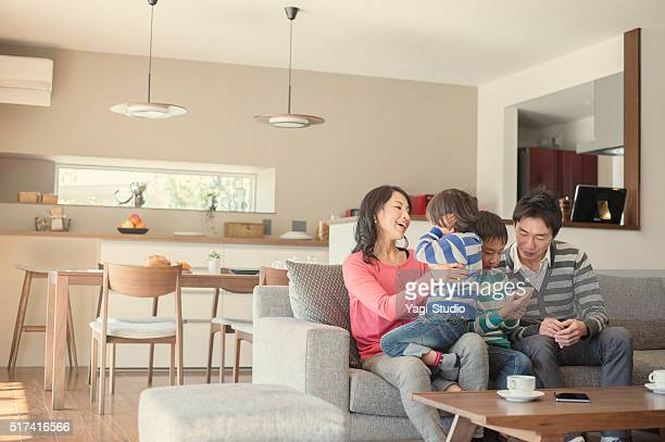 Family relaxing in the living room