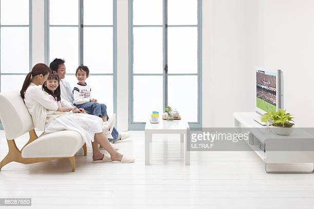 A family relaxing in the living room.