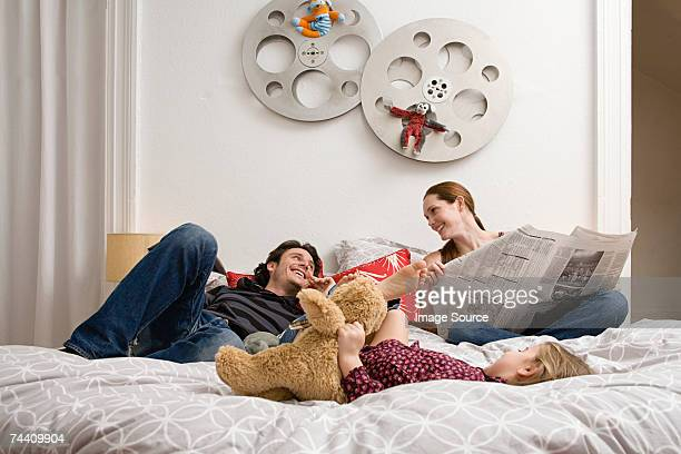 Family relaxing on bed