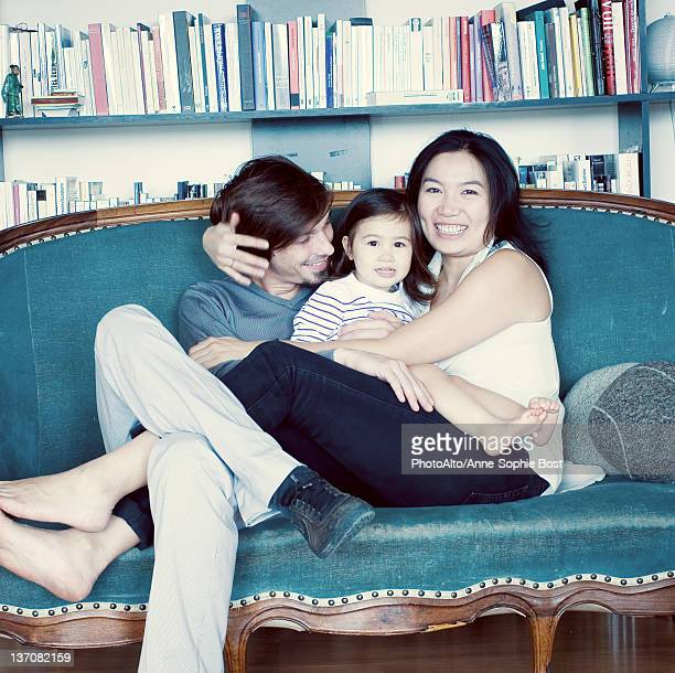 Family relaxing on couch, portrait