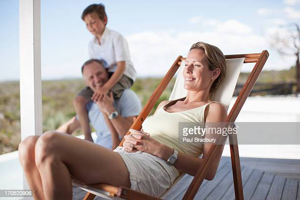 Family relaxing on deck