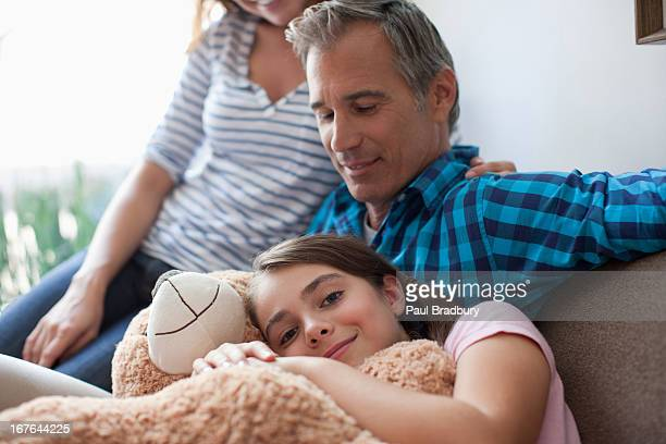 Family relaxing on sofa together