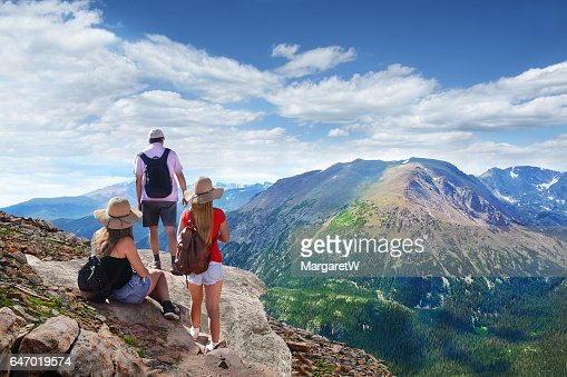 Family relaxing on top of the beautiful mountain. : Stock Photo