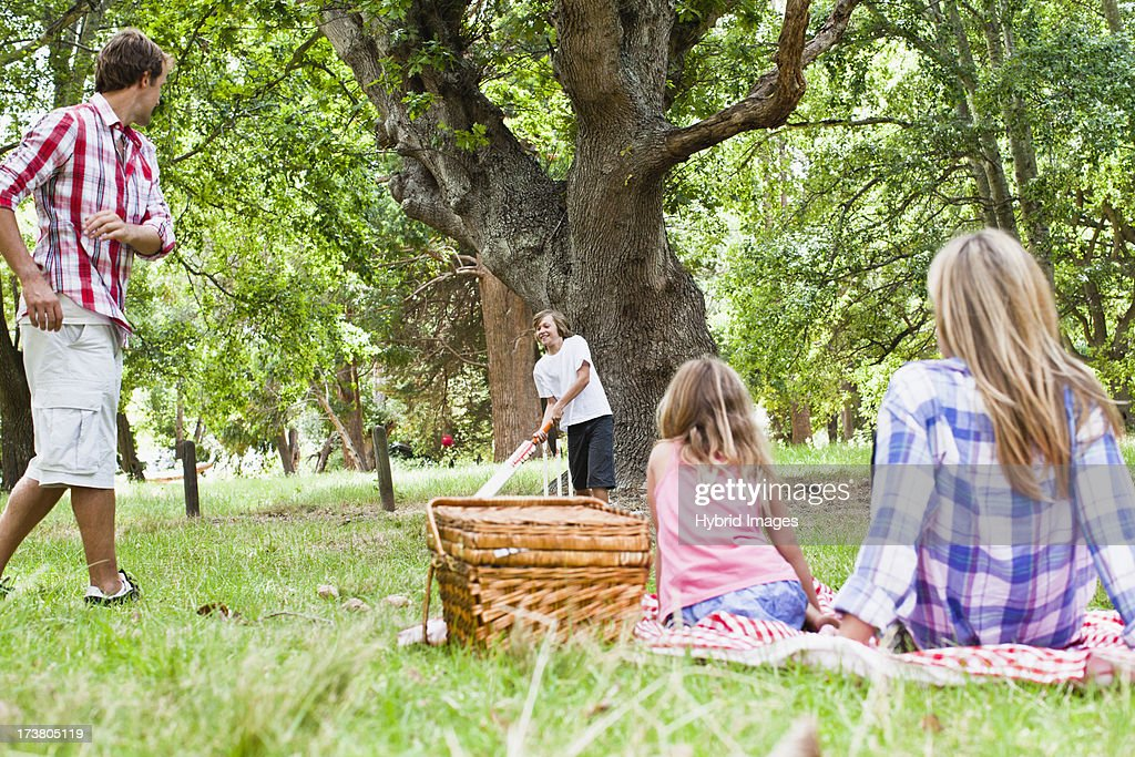 Family relaxing together in park