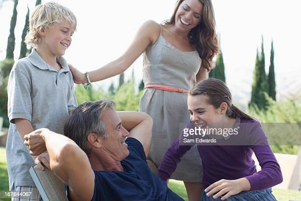 Family relaxing together outdoors