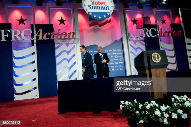 Family Research Council President Tony Perkins walks away after introducing US President Donald Trump during the Family Research Council's 2017 Value...