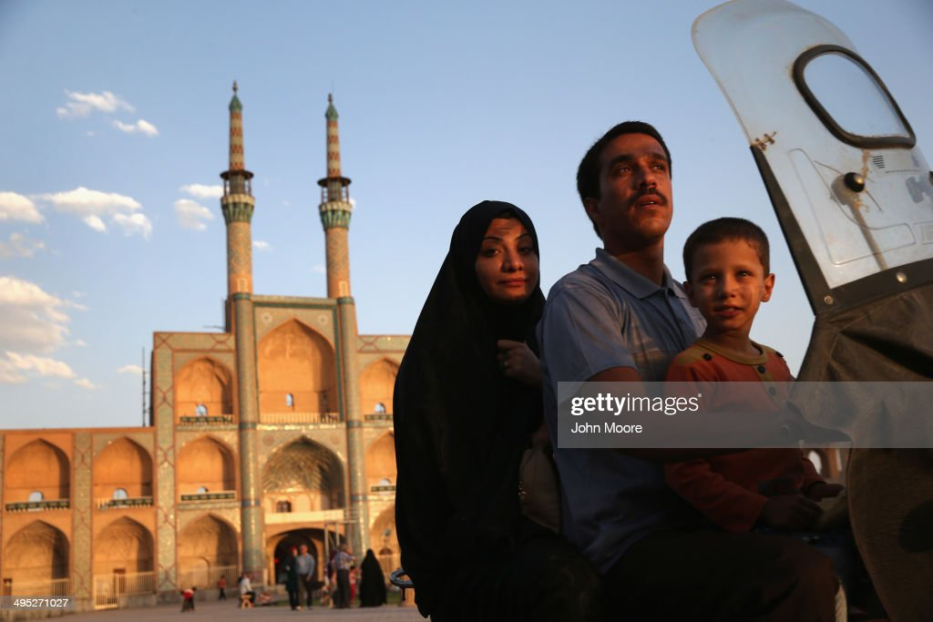 A family rides a motorcycle past the Amir Chakhmaq Hosseinieh worship site, one of the largest such structures in Iran, on June 1, 2014 in the desert town of Yazd, Iran. On June 4, Iran marks the 25th anniversary of the death of the Ayatollah Khomeini and the legacy of his Islamic Revolution.
