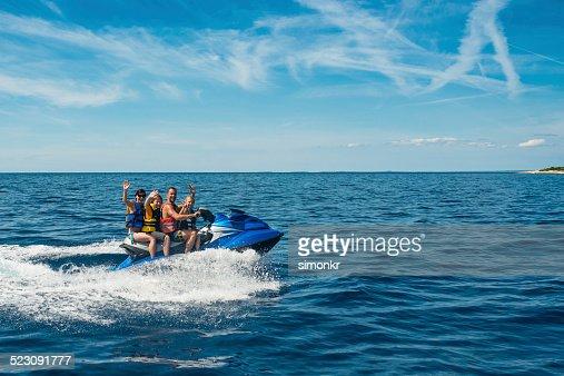 Family Riding A Jet Boat : Stock Photo