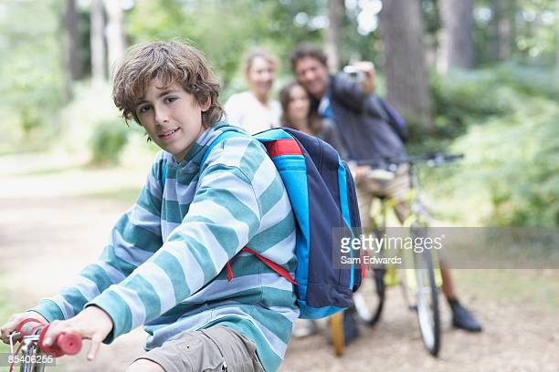 Family riding bicycles in woods