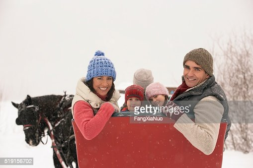 Family riding in horse drawn sleigh