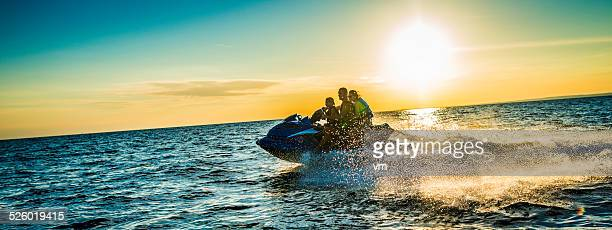 Family Riding  Jet Boat at Sunset