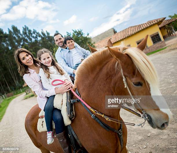 Family riding on horses