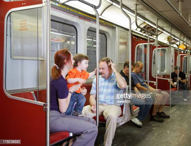 Family Riding The Subway Train