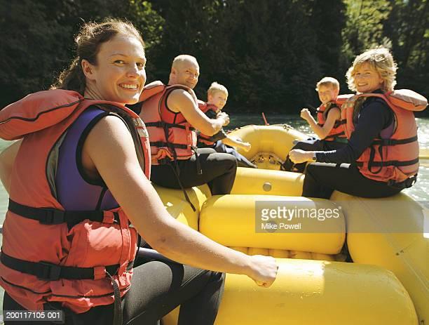 Family river rafting, boys (8-10), portrait