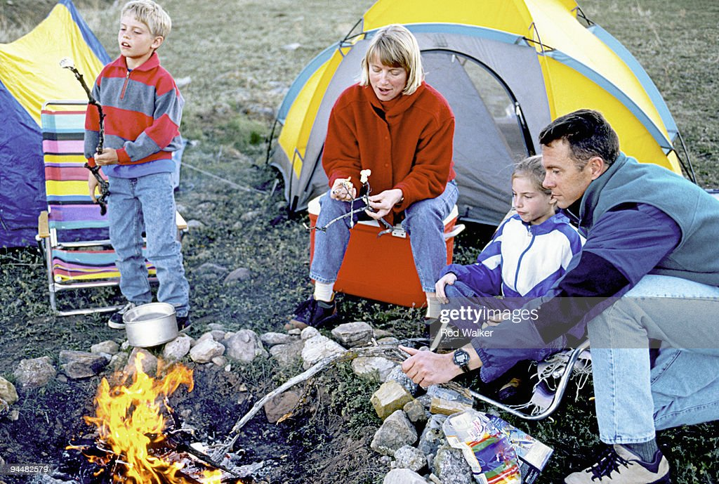Family Roasting Marshmallows In Front Of Campsite Stock ...
