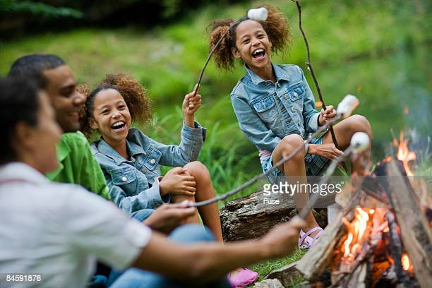 Family Roasting Marshmallows over a Campfire