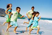 Family running along beach