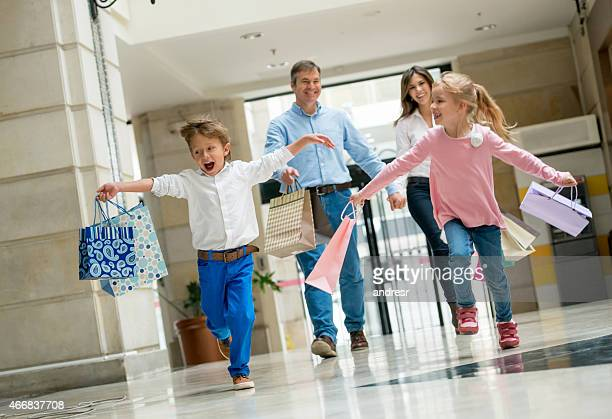 Family running at the shopping center