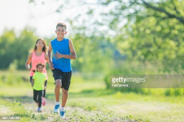 Family Running Following Boy