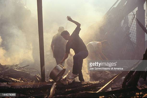 Family salvaging possessions after riots South Central Los Angeles California