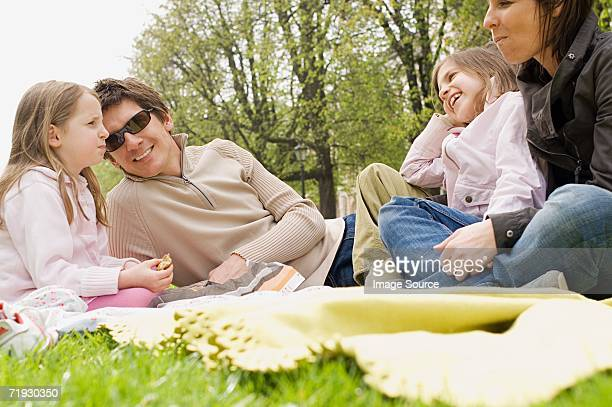 Family sat in a park