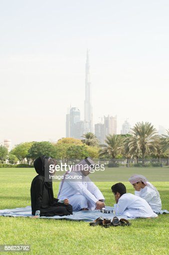A family sat in a park playing chess