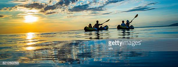 Family Sea Kayaking at Sunset