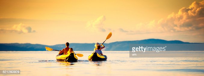 Family Sea Kayaking at Sunset