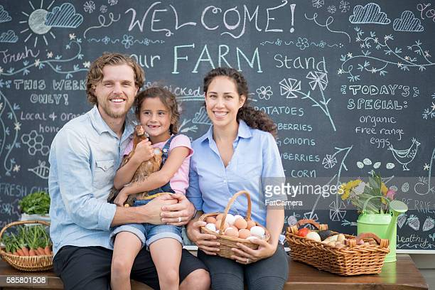 Family Selling Food at Their Farm Stand