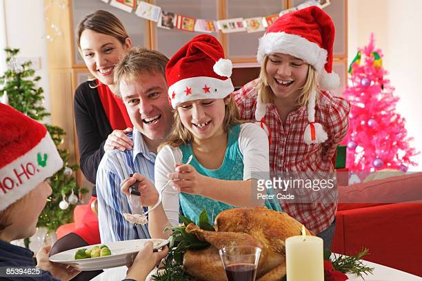 Family serving christmas dinner