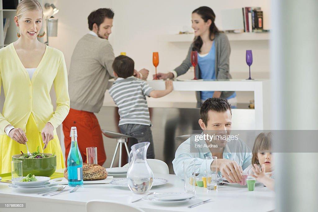 Family setting table for dinner