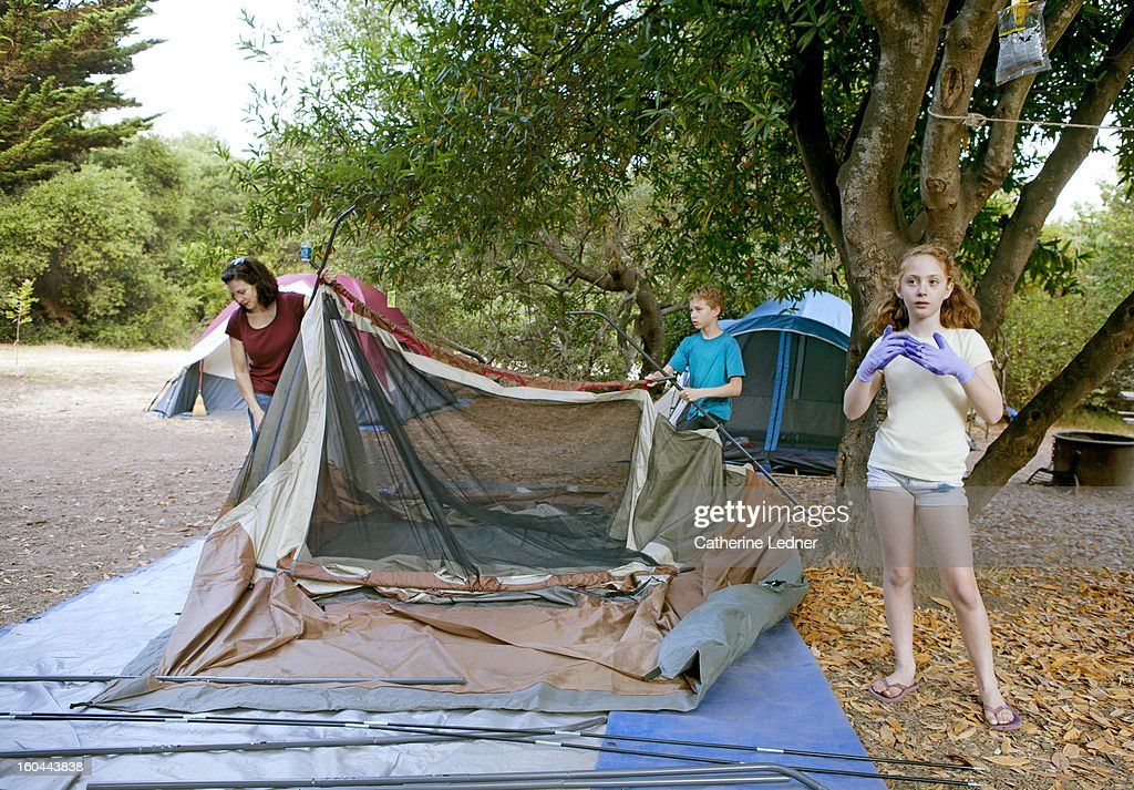 Family Setting up Tent at Campsite : Stock Photo