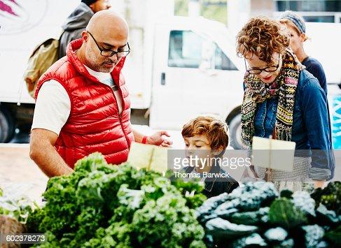 Family shopping at organic farmers market