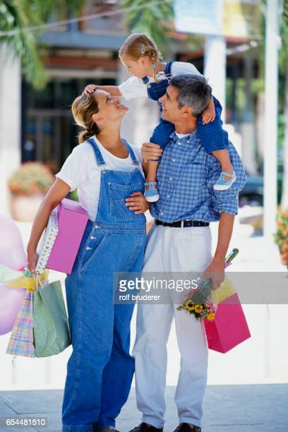 Family Shopping for Expectant Mother