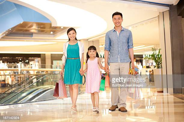 Family shopping in department store