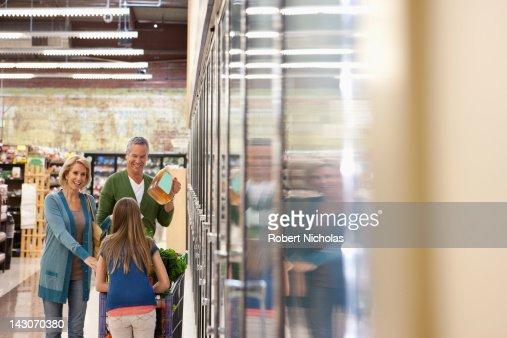 Family shopping in supermarket : Stock Photo