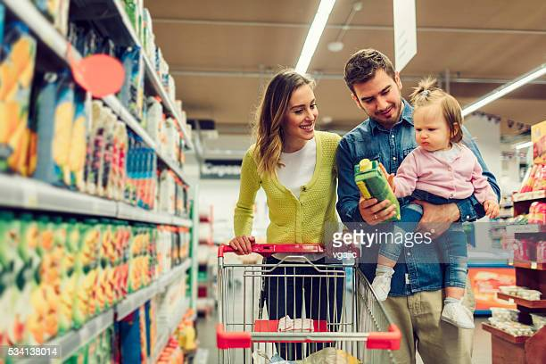 Family Shopping In Their Local Supermarket.