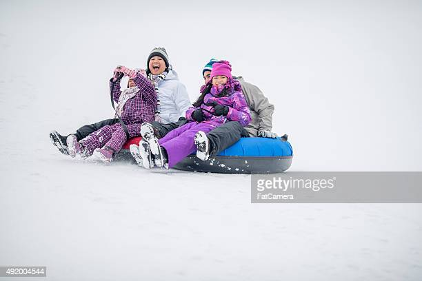 Family Shouting While Going Down a Hill on Inner Tubes