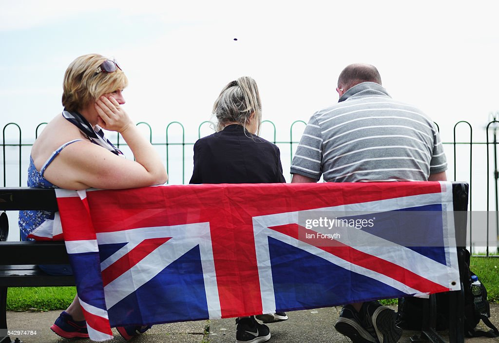 A family sit and wait for events to begin during the Armed Forces Day National Event on June 25, 2016 in Cleethorpes, England. The visit by the Prime Minister came the day after the country voted to leave the European Union. Armed Forces Day is an annual event that gives an opportunity for the country to show its support for the men and women in the British Armed Forces.