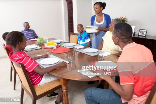 Family Eating At Dining Room Table Johannesburg South Africa Stock