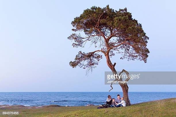 Family sitting at sea