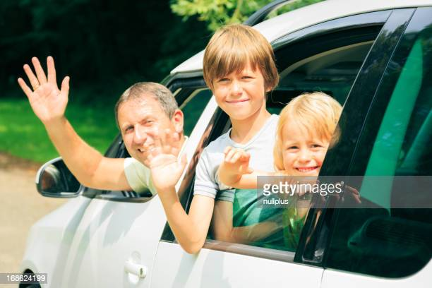 family sitting in their car