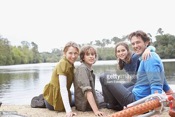 Family sitting near lake