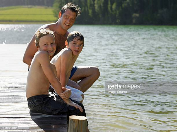 Family sitting on a pier