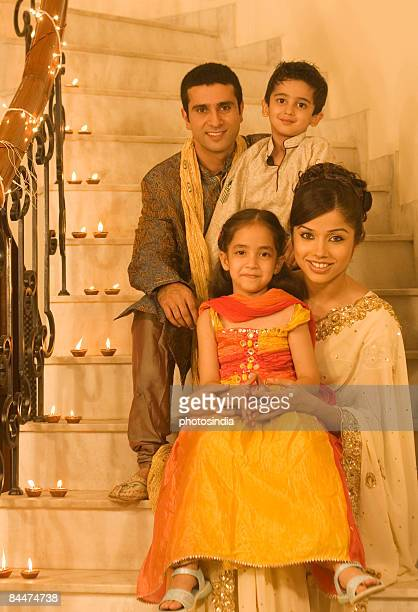 Family sitting on a staircase and smiling